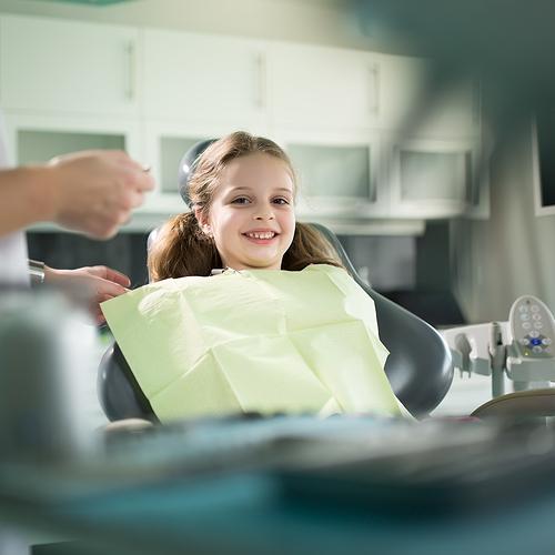 happy kid at pediatric dentist